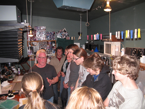 Kim Weston in his darkroom with Kirby High School students