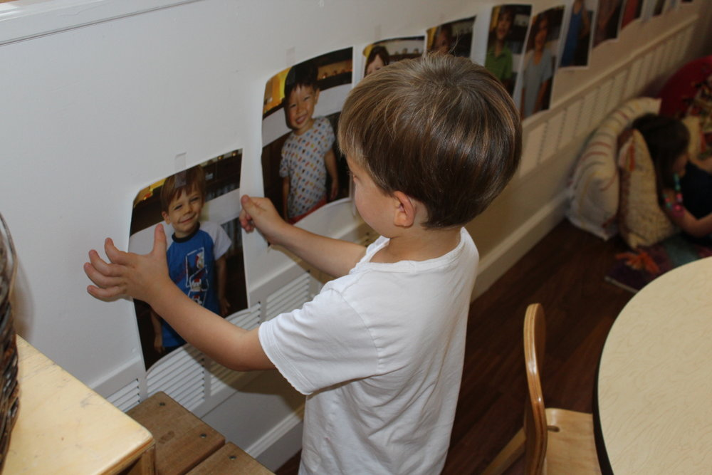 Today we put up photos in the classroom and practiced names! Here's Nolan taking his turn to put up his picture