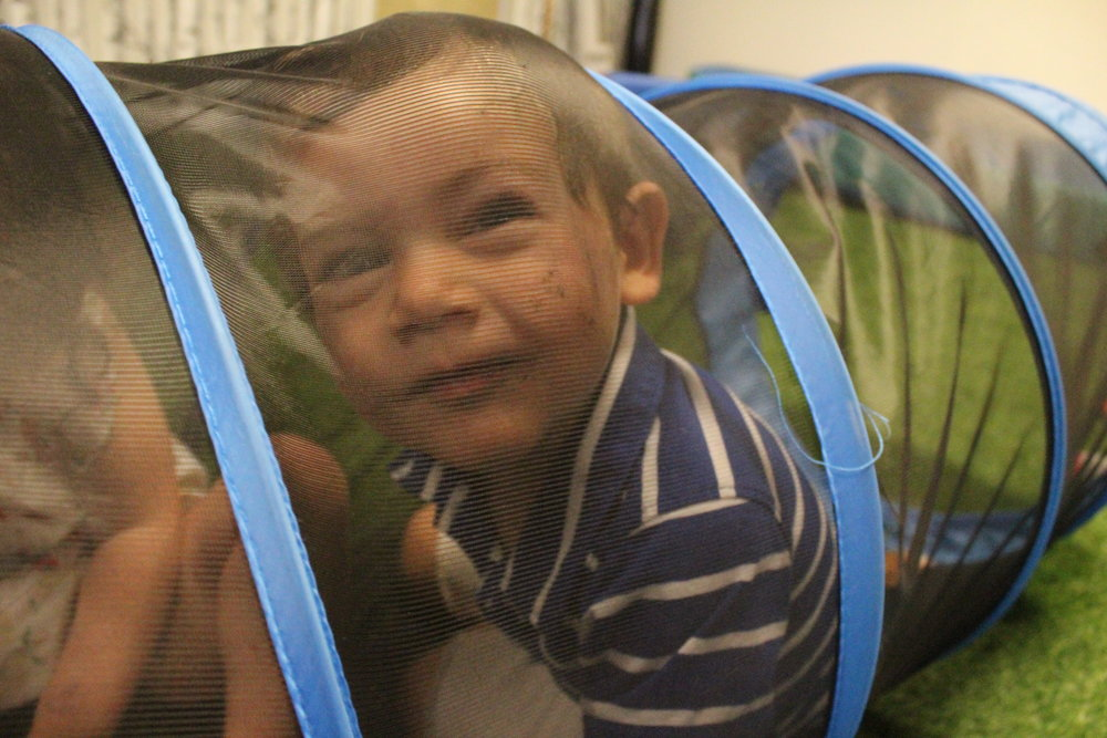 Hiding in the tunnel! Angelo was excited to help me count how many friends could fit inside.