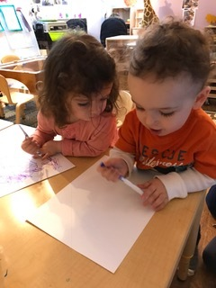 Ava drawing raviolis and Joseph on his second page of Noodles!