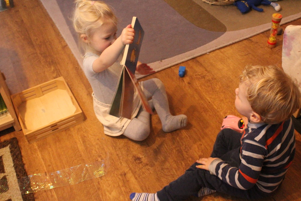 Charlie read a story to her friend Samuel today.