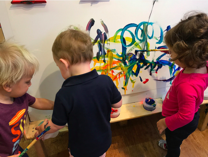 Our friends working alongside one another at the easel! Easel activities promote language development as the children are standing side by side one another. They can work togehter, comment on each other's work as their language progresses, and it builds on fine and gross motor skills.