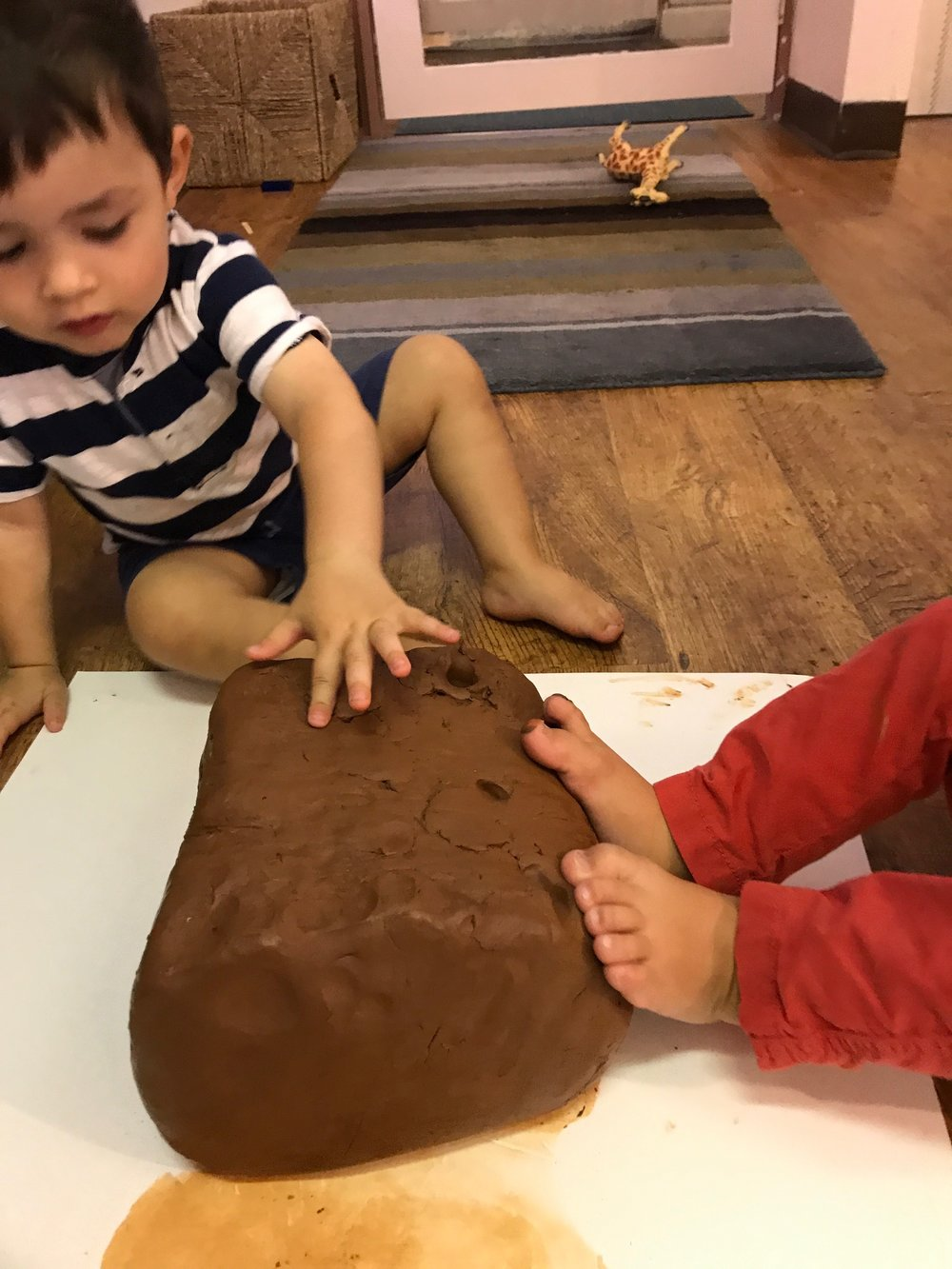 This week we used our whole bodies and especially feet to explore clay. We did a lot of pounding and pulling because we wanted to lift the clay off the paper. Lots of grunting and effort were involved in the process. We were super proud of our dedicated workers.