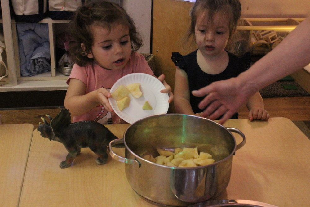 Cooking is a great way to encourage children to work alongside one another and share. As of late we've really begun seeing a shift in the children from working alongside of each other to working cooperatively with one another - this ranges from the children passing the bowl to one another, inviting each other to take a taste of whatever we've cooked, and beginning to start a dialogue with each other!