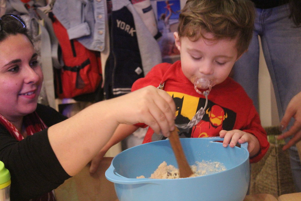 Max enjoying cooking this week with his mom! Max enjoyed sampling the chocolate chips from our recipe and working alongside his friend and mother!