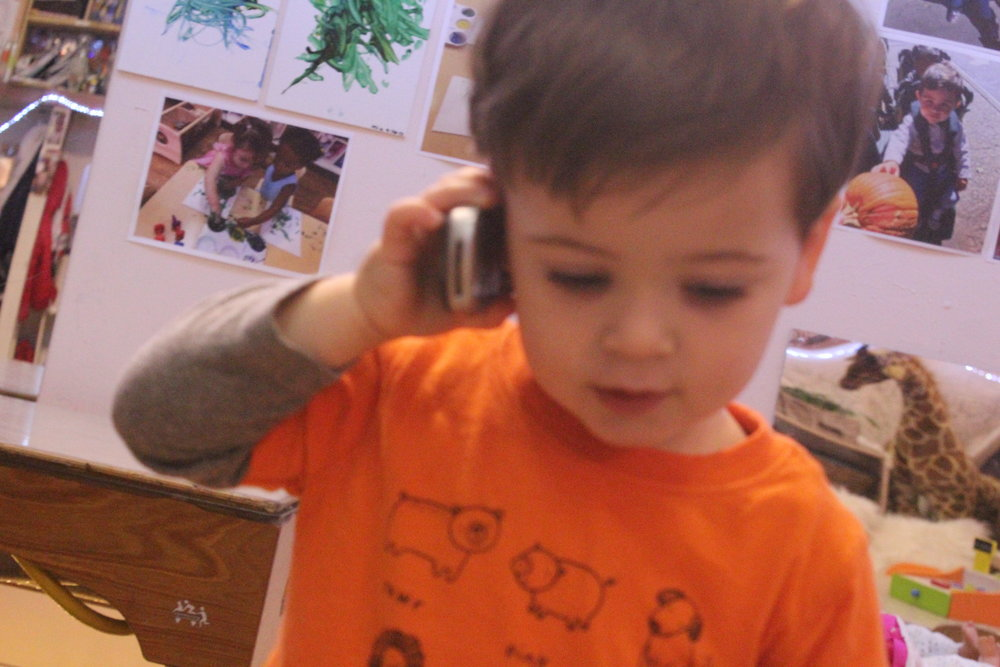"""This week we continued our exploration into dramatic play  """"Hello? Hahahaha!"""""""