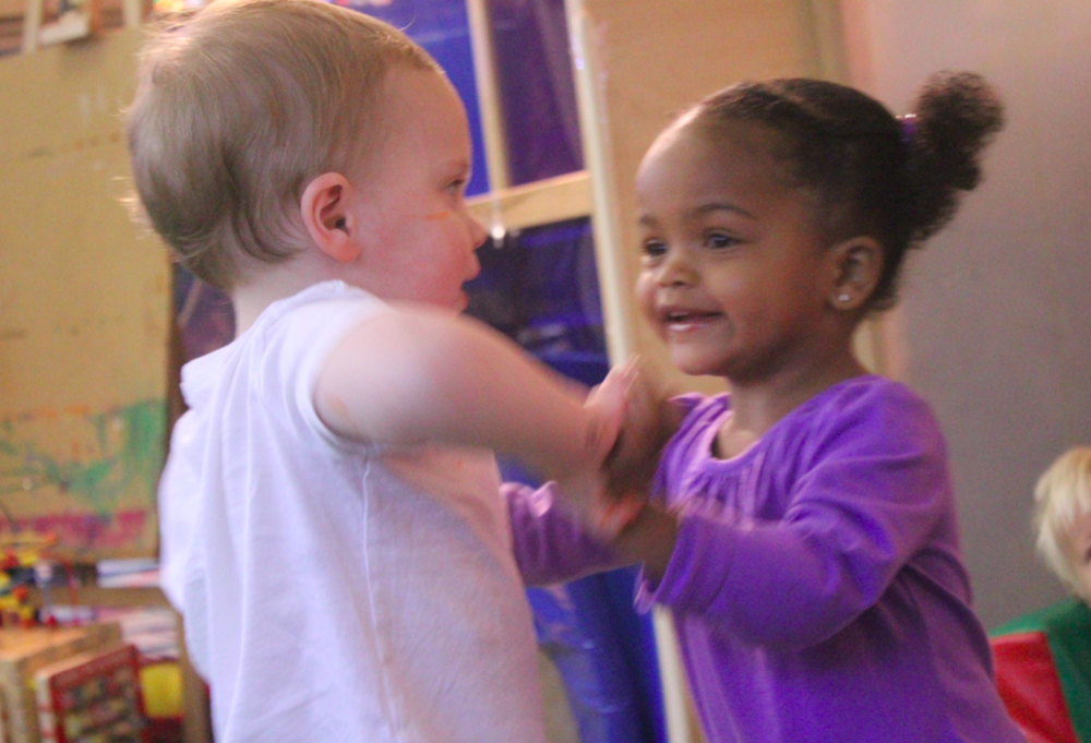 "One of the things that we love the most is dancing! Here's a photo Mia and Parker spontaneously playing ""Ring Around the Rosie""."