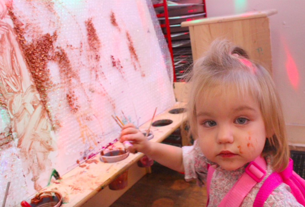 Charlotte painting at the easel! This week, she spent quite a bit of time here - and would excitedly try to invite her friends and teachers to paint alongside of her.