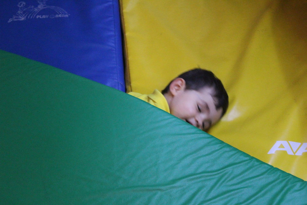 """Night, night!"" - Emilio  Emilio demonstrating a key toddler play skill - imitating others by pretending to sleep - all the while doing it with a smile and humor!"