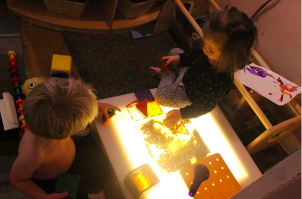 We've started seeing a shift from parallel play (playing  alongside  one another) to cooperative play (engaging and playing  with  one another). In this photo, Nicholas and Katerina are building a house with one another (One of Nicholas's most favorite things to do as of late).