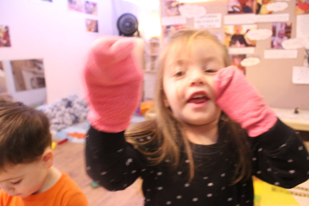 "Katerina using socks as ""mittens"" - imagining objects as something else is a key toddler play skill"