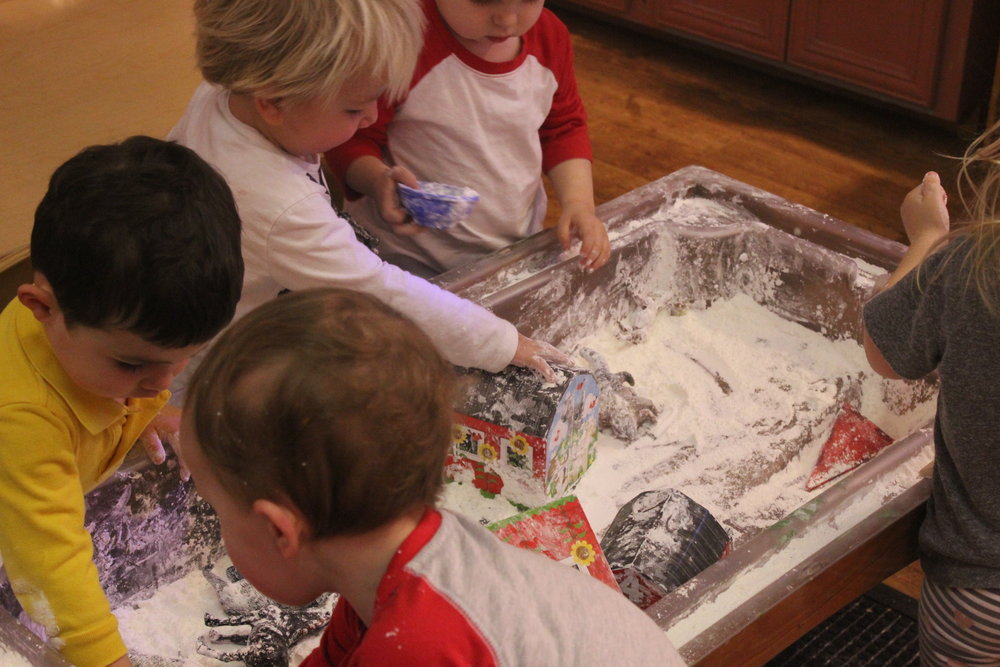 Playing with our snowy sensory farm!