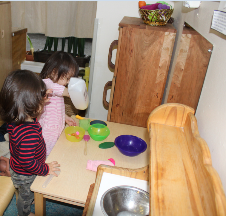 Friday, January 13, 2018- Rheya and Edith playing in the kitchen center.PNG