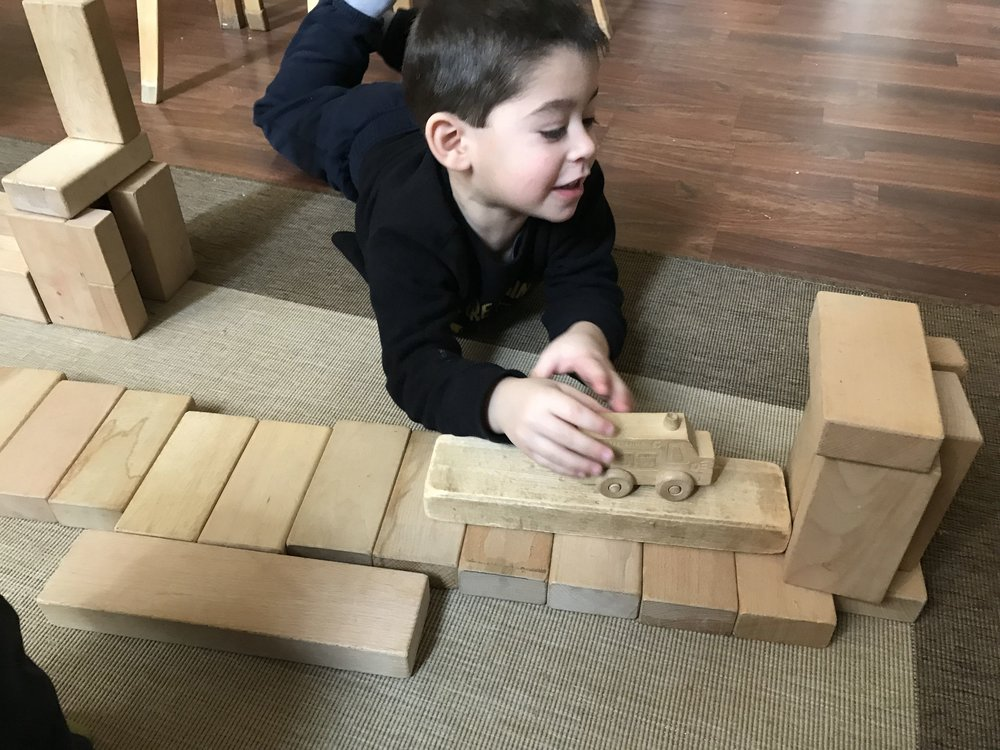 Dylan remembered that at the last workshop he made an airport.  This time he made another airport, but with a pathway for cars to enter.