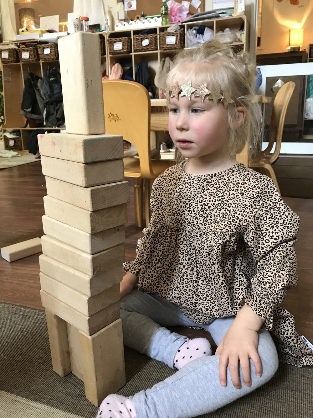 Charlie experimented with height by placing her blocks in different directions.
