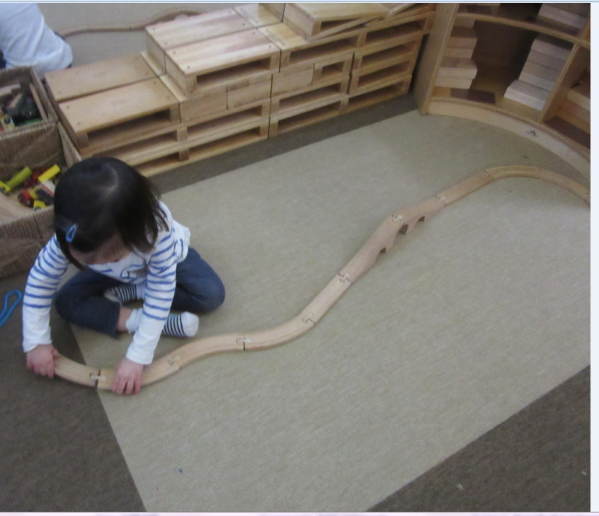 Train tracks are not only fun but developmentally appropriate for young toddlers.  They are tools that help facilitate optimum child growth and development.  Last week I noticed Edith developing an interest in building the train tracks.   Each piece stimulates Edith's imagination and creativity.  It also enhances problem-solving skills.   Edith created her own track configuration.   She carefully chose and connected each track.  She observed and focused on each track, making sure it fits.