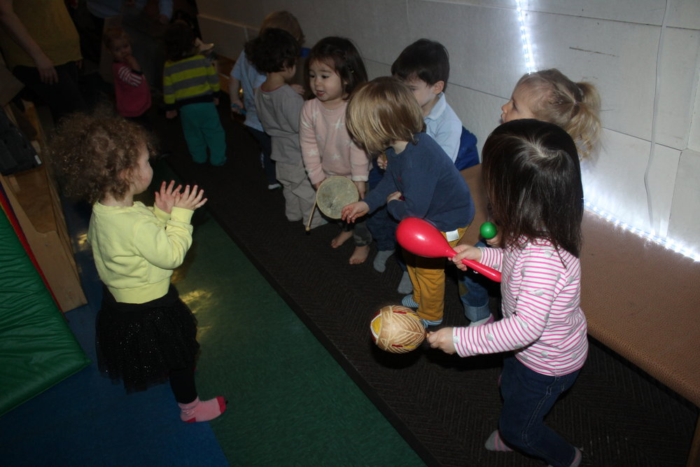 "Part of our curriculum is to provide music.  The words and instruments are the special elements that make the music come alive.  Children smile, jump, clap, and sway to the music they hear. These experiences promote the development of listening and language skills, motor skills, and creativity.   We visit the ""Music Wall"" and the children explored and manipulated different instruments in the basket and the guitars displaying on the wall.  As they played an instrument they sang ABC, Mr. Sun, and Twinkle Little Star to name a few.  Music and movement contribute to children's overall development.  Listening to and making music helps children's developing brain.   As children learn words to songs, it makes them feel proud and able to participate in singing."