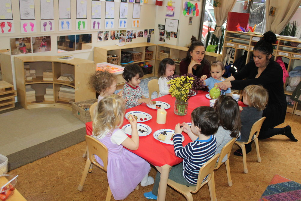 The children were eating strawberries, muffins, raisins, and cherry scones at their Tea Party. They wore their different hats as Hooray for Hats was being read to them.  The also enjoyed a cup of apple juice served from a Teacup.