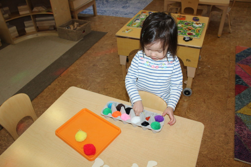 We used an egg carton and different color tempera paints, to create a color recognition game. The children enjoy interacting with fuzz balls; therefore, creating a fun and learning experience allows them to absorb information simply.  Harlow, Mario, Rheya, and Edith appeared excited to recognize and identify the colors as they insert the fuzz ball into its correspondent place.