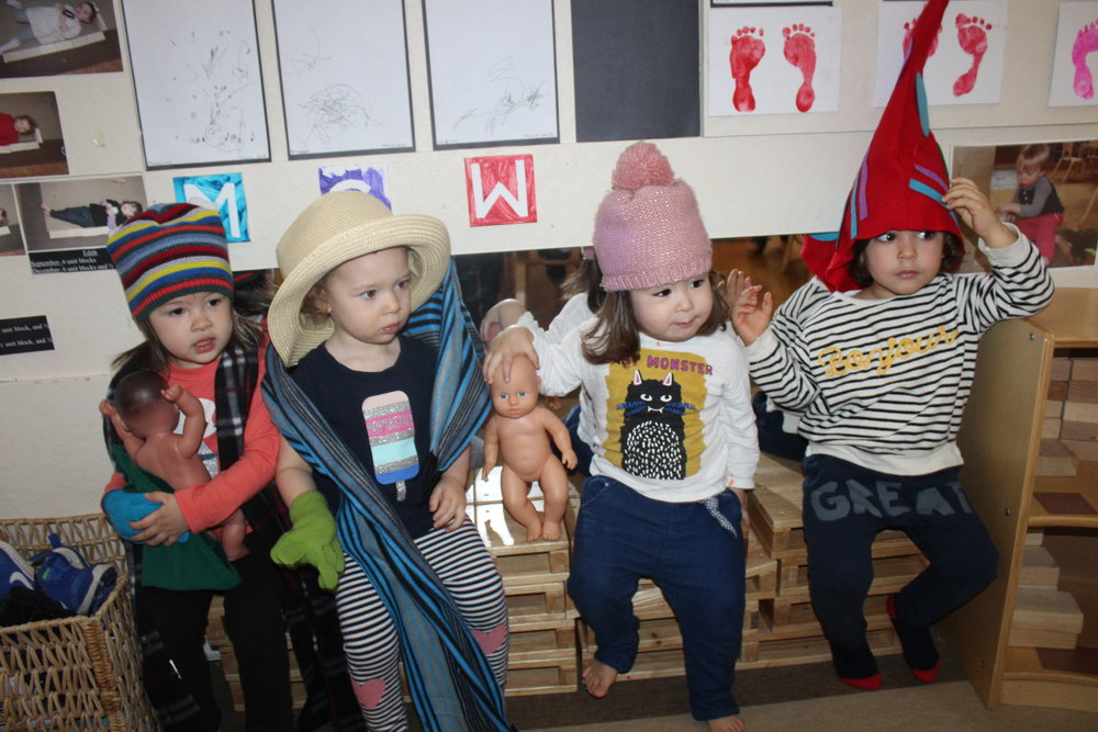 The children selected different hats to wear during this week.  They shared, and they also had their favorite hat to wear.  Even though we focus on children wearing them during Literacy Week, they will incorporate them during pretend (dramatic) play.  When children engage in pretend (dramatic) play, they are actively experimenting with the social and emotional roles of life.  Through cooperative play, he/she learns how to take turns, share and creatively problem-solve.  When children pretend to be different characters, they have the experience of walking in someone else's shoes.  They also build self-esteem when he/she discover they can be anything just by pretending!
