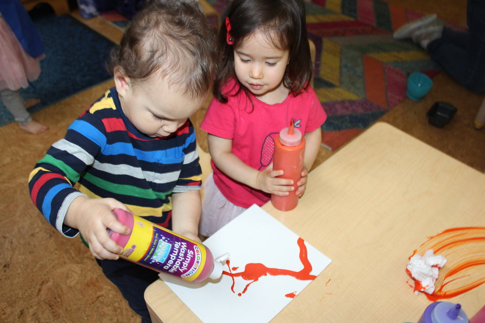They used a variety of colors to create a wonderful painting on canvas. They appeared curious as they patted, and lightly touched and rubbed the bag. They demonstrated eagerness, as they continued to manipulate the paint, and discovered how the paint spread inside without getting paint on their hands. Color, sensory, imagination, and fine motor skills all in one experience. Giving children opportunities to play with different types of textures and objects helps them to build new ways of talking about the world.