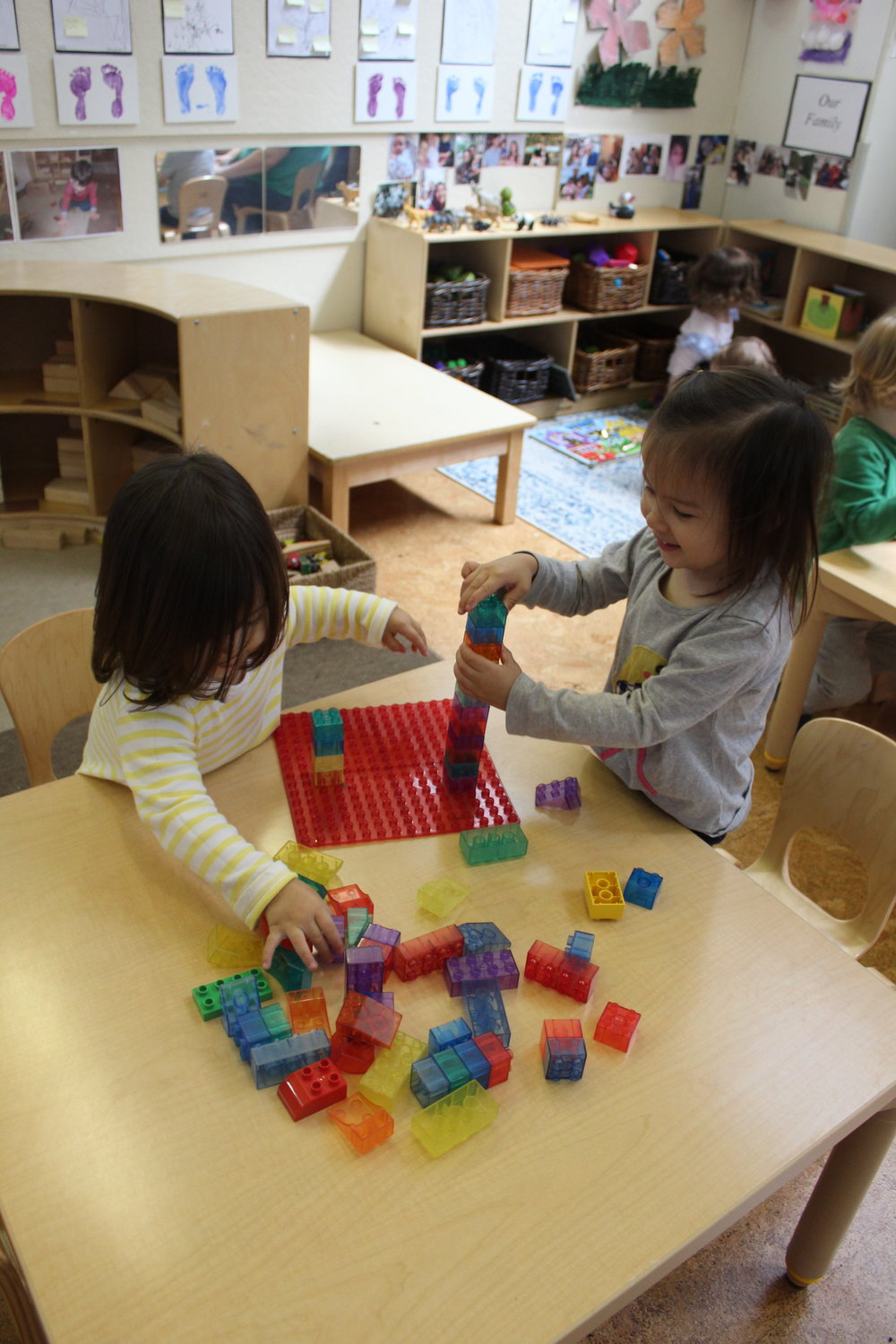 Lego Block promotes color recognition, counting, one to one correspondence, and fine motor skills.   Creativity and imagination also develop as children engage in connecting and building.    As young toddlers play, they build their physical skills, learn concepts, and apply thinking skills. As teachers, we encourage children to explore with toys and manipulative.     We promote socialization by encouraging children to play with one another and we create activities that enable children to work collaboratively.