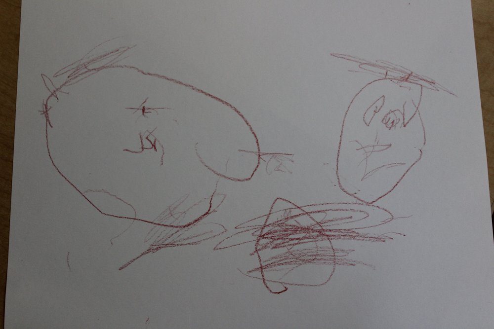 Harlow drew her teachers, Janet on the left and Sandra on the right. Harlow asked Janet what Sandra needs (referring to the different facial features). When Janet told her that Sandra needs ears and hair, she drew them exactly where they suppose to be.  She included Sandra's bun!