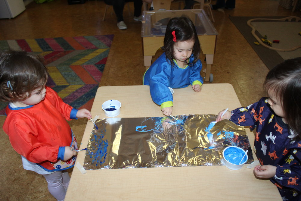 Using tin foil and paint, the children delve into exploring using their hands and fingers. In process art there is no step-by-step instruction, there is no right or wrong way to explore and create. The art is focused on the experience, and on the exploration. The art is unique and original. For some children, the experience is relaxing or calming as they feel the paint between their fingers.