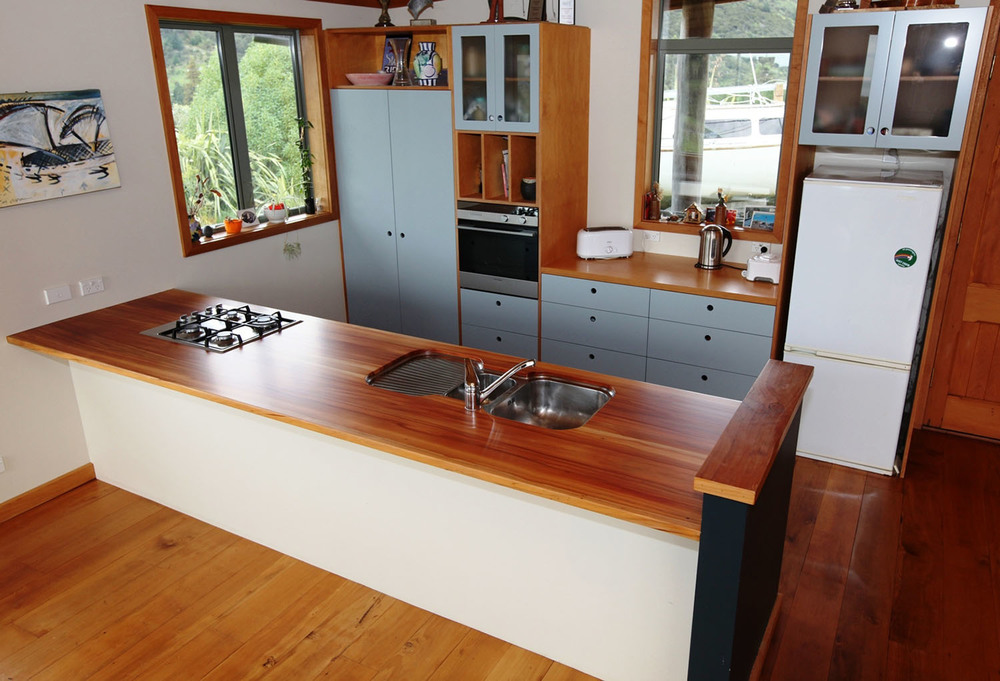 Hoop pine panels, lacquered fronts, Matai flitch top