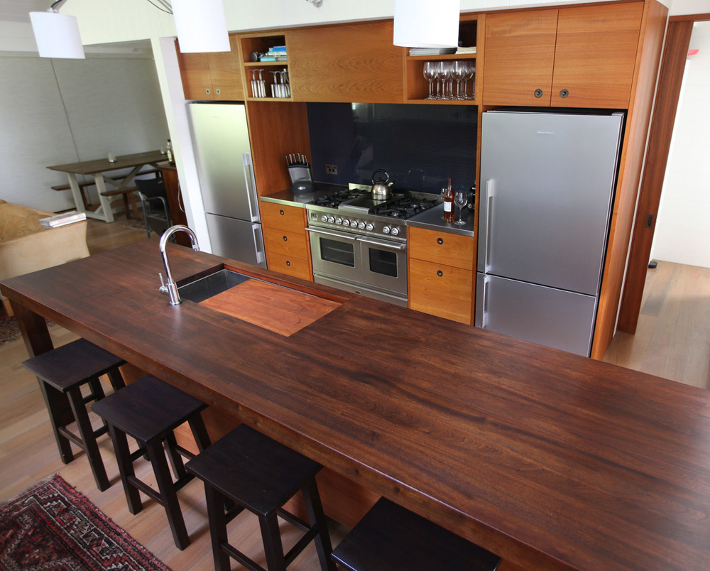 Oiled solid teak fronts, solid mahogony island and stainless benchtop
