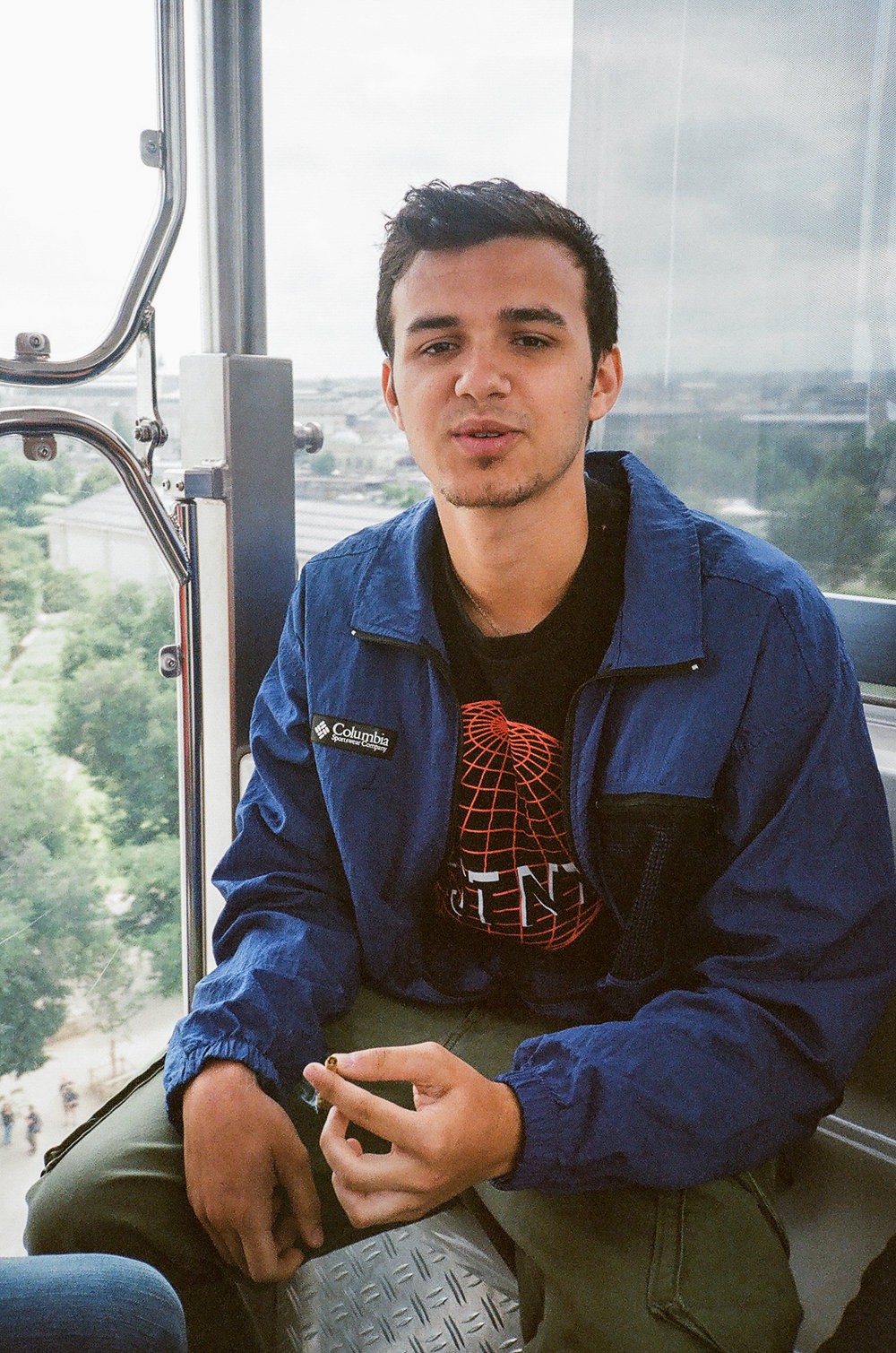 Marcelo smoking on a Ferris Wheel in Paris