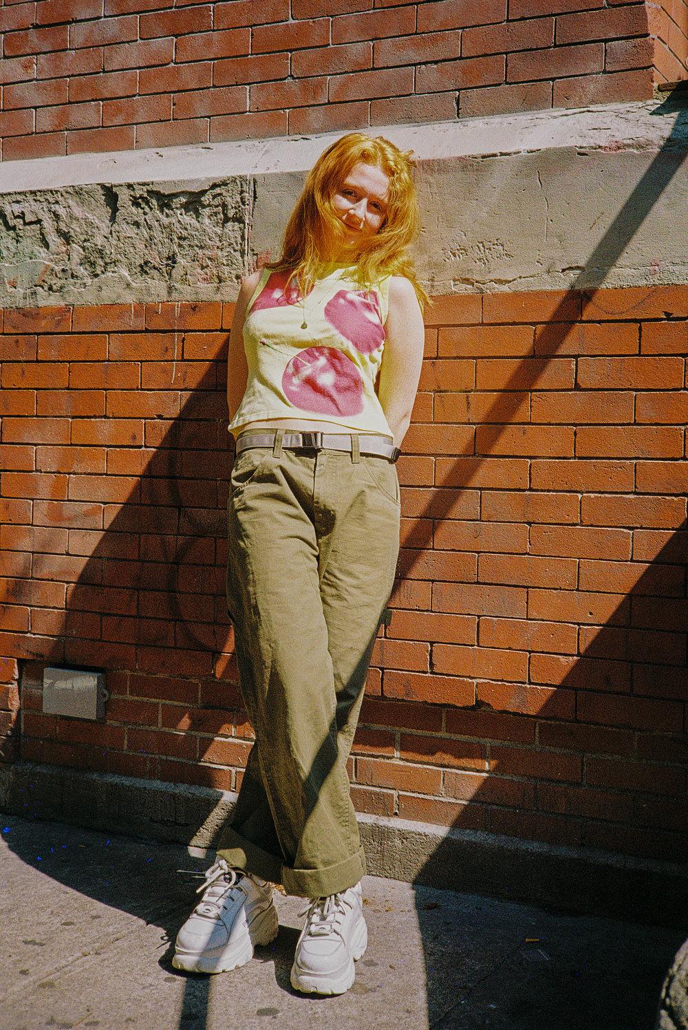 Franscis during work in SoHo in her cherry shirt