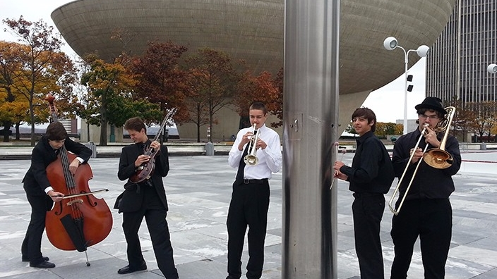 "The Empire State Youth Jazz Ensemble formed in 1986, is ESYO's premiere Jazz Ensemble and has worked with guest artists such as ""Blue"" Lou Marini and Allen Vizzutti, and Grammy-award winning pianist/composer Bill Cunliffe."