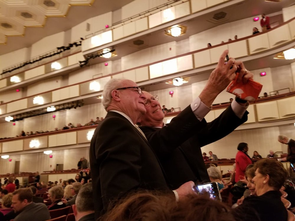 Symphony Board Members Barry Richman and Steve Lobel documented this historic moment by taking a #SymphonySelfie as the musicians warmed up their instruments and the audience found their seats.