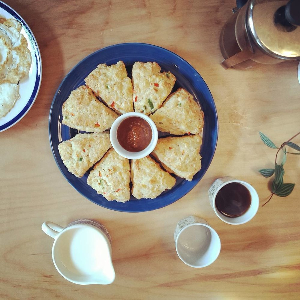 Scone, Coffee + Chutney   Homemade queso fresco jalapeno scones, eggs(over easy) & red Chutney