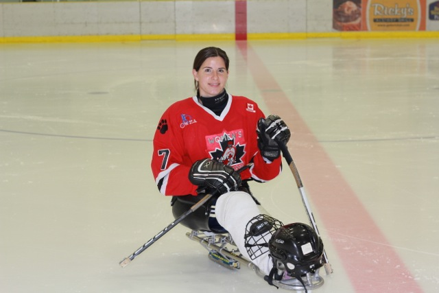 sledge hockey player with amputation