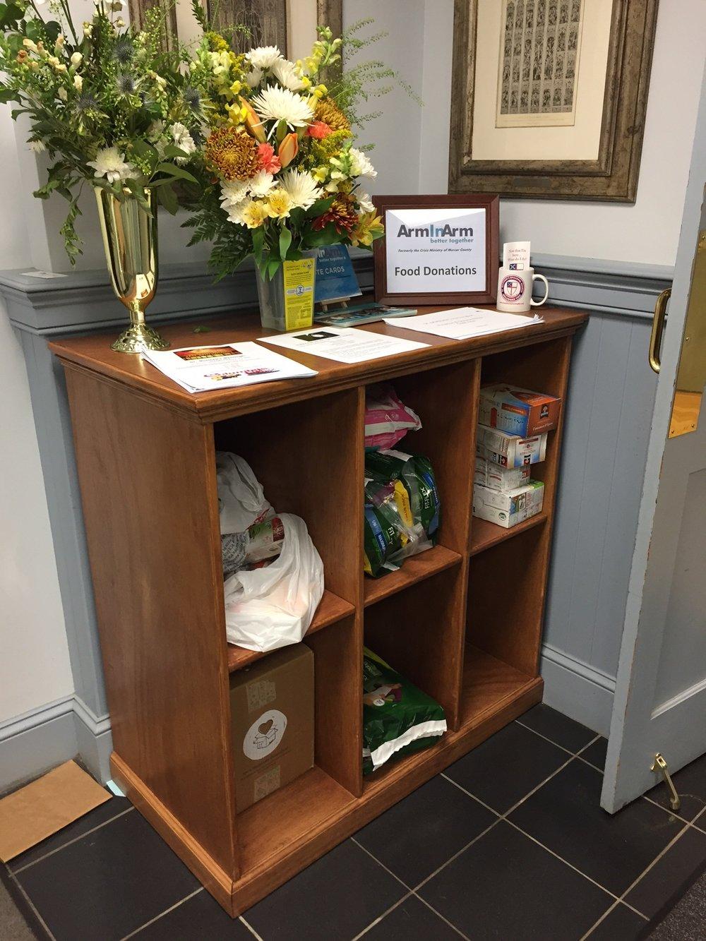 Arm in Arm lobby cabinet.JPG