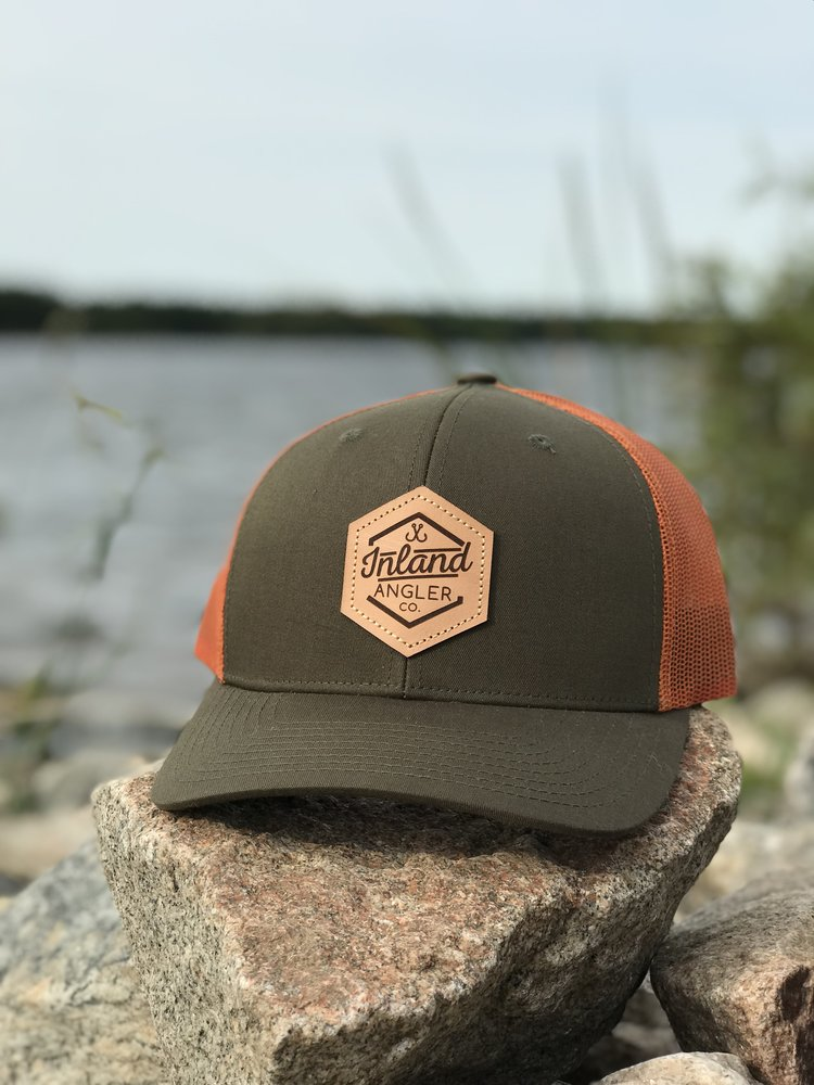 c115a0e870d14 Leather Patch Trucker Hat (Hunter Green Orange) — Inland Angler Co.