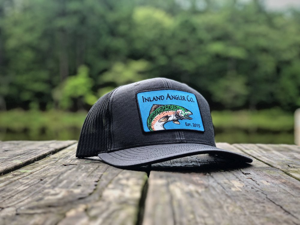 13895ebcd3cfa Rainbow Trout Patch Trucker Hat (Charcoal Black) — Inland Angler Co.
