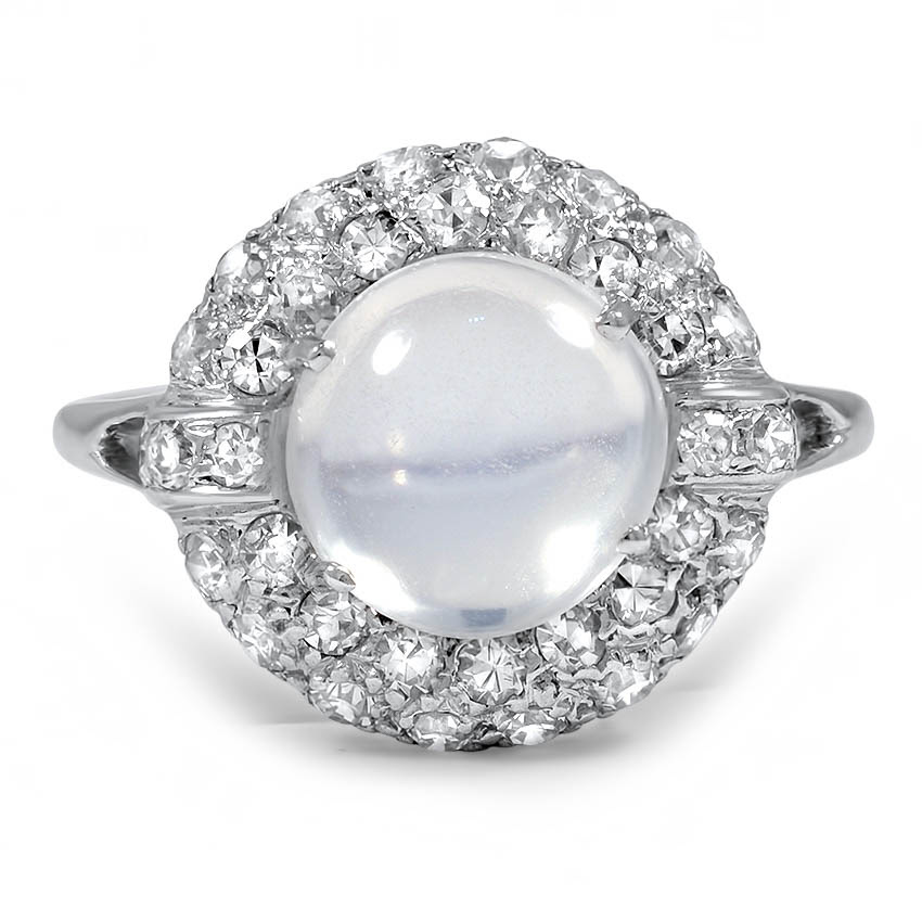 The Christina Ring, $3,140, featuring moonstone cabochon surrounded by a glimmering halo of thirty-six diamonds