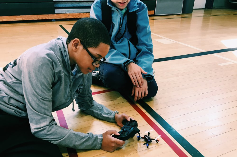 STEM Camp for kids in afterschool activity building drones.