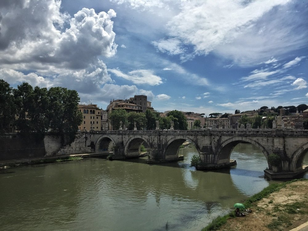 Just one of many beautiful, old bridges in Rome that cross the River Tiber.