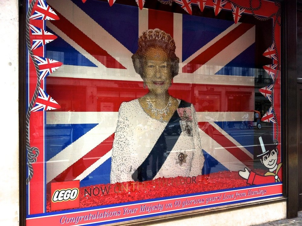 LEGO portrait of The Queen          Jeri & I were walking down Regent Street, our first time in London together since 1997… wow!  We came upon Hamley's Toy Store but they were closing just as we arrived; it was a Sunday evening… however they had this nice portrait of Queen Elizabeth II in the window for her (then) upcoming Jubilee!
