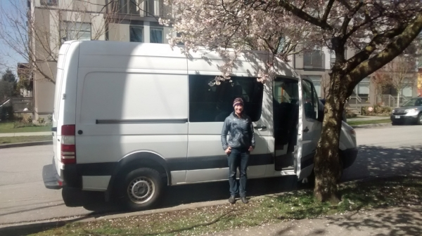 Eliza in front of her new camper van: a perfect vehicle for scouting locations for her second social venture.