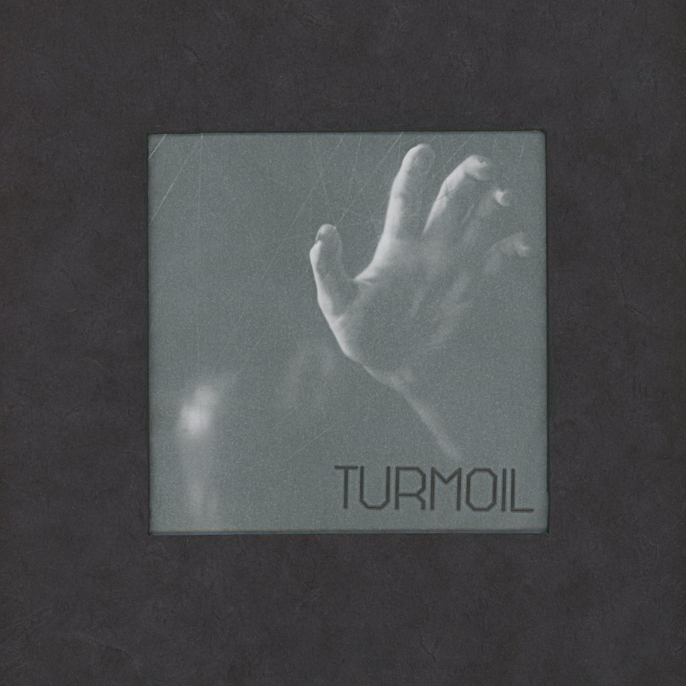 """A Handmade book created to display images from my """"Turmoil"""" series along side poetry."""