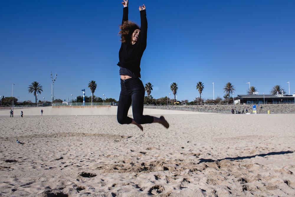 jumping at the beach
