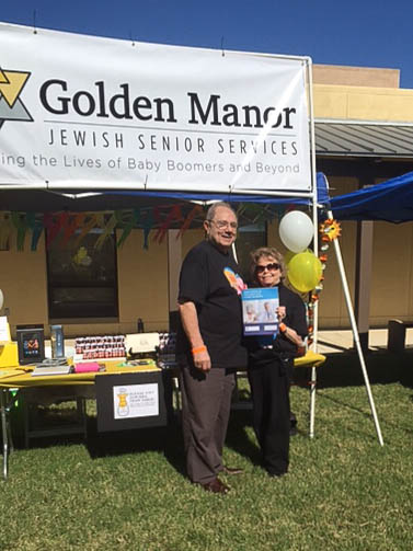 Steve and Phyllis Cole with a Taking Control of Your Healthcare guide at the Golden Manor Booth
