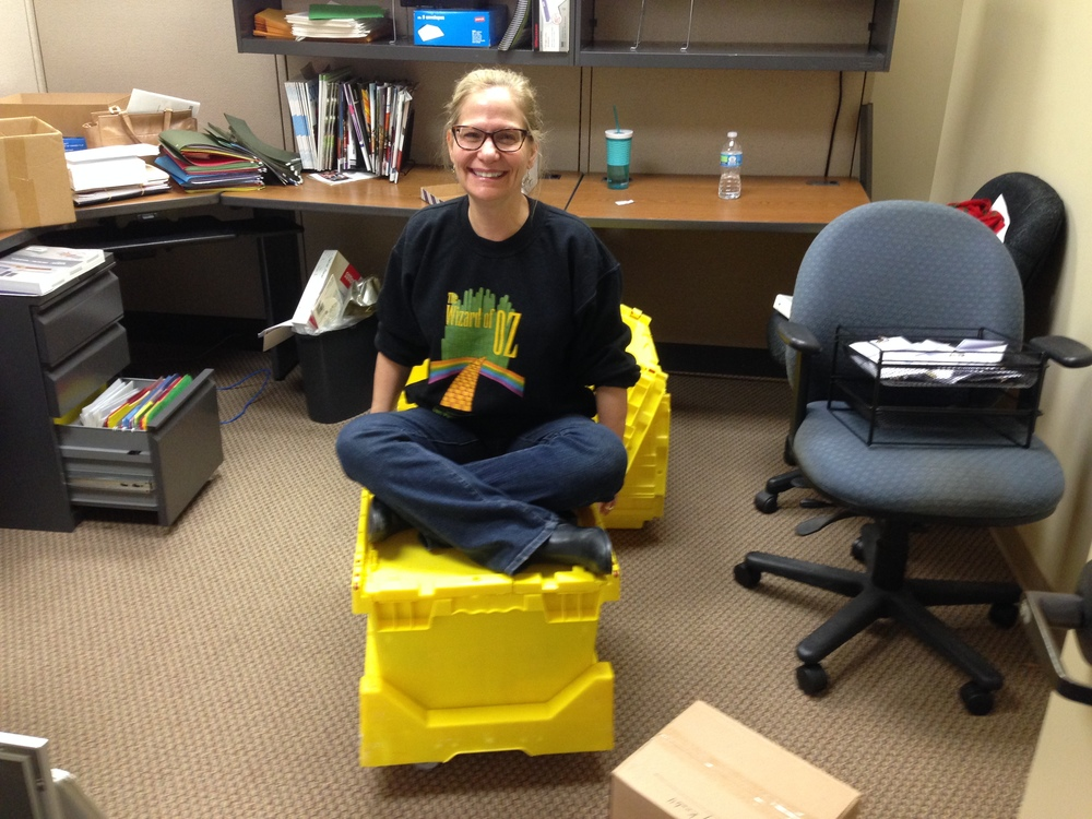 President and CEO Varder Ratner has fun while packing for the move