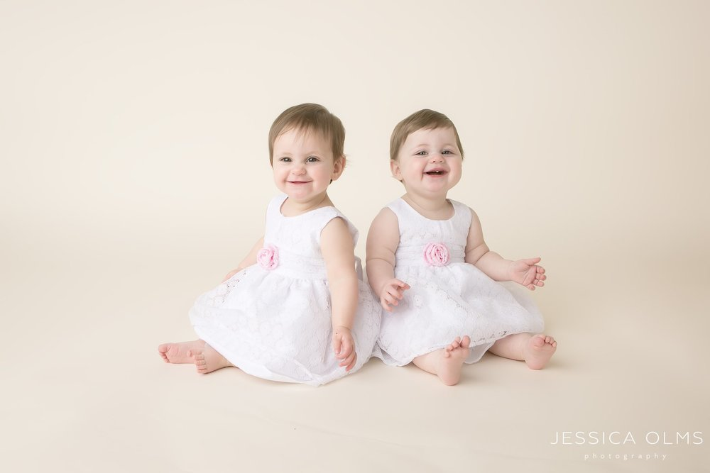 twin girls in white baptism dresses 9 months columbus ohio baby photographer