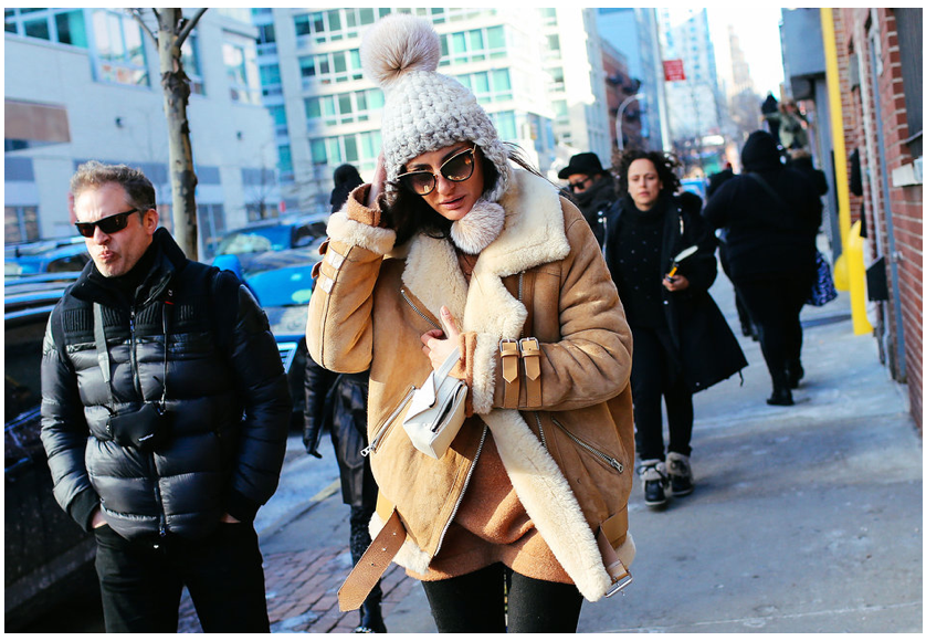 Giovanna Battaglia in her Acne Studios leather and shearling jacket during fashion week